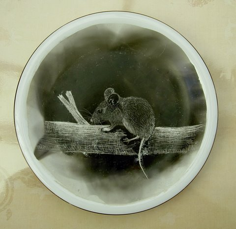 A picture created by etching in the carbon left by a smoking candle