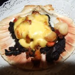 Smoked black pudding with smoked scallops and an hollanddaise sauce