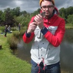 Tom - fishing champion - with one of the four trout he caught