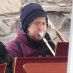 A member of Appleby in Westmorland Town Band on her trombone