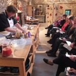 Jo demonstrating how to prepare and slice a side of home-smoked salmon