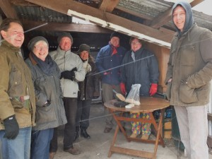 Huddling in the smoking shed as the snow whistles by