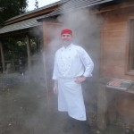 Miroslav posing outside the smokehouse in the dry